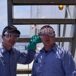 4/C Gill and Beecher wearing proper PPE for rust removal using an acid solution