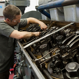 Student working on engine
