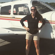 Kylie in front of plane