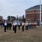 Students by flagpole